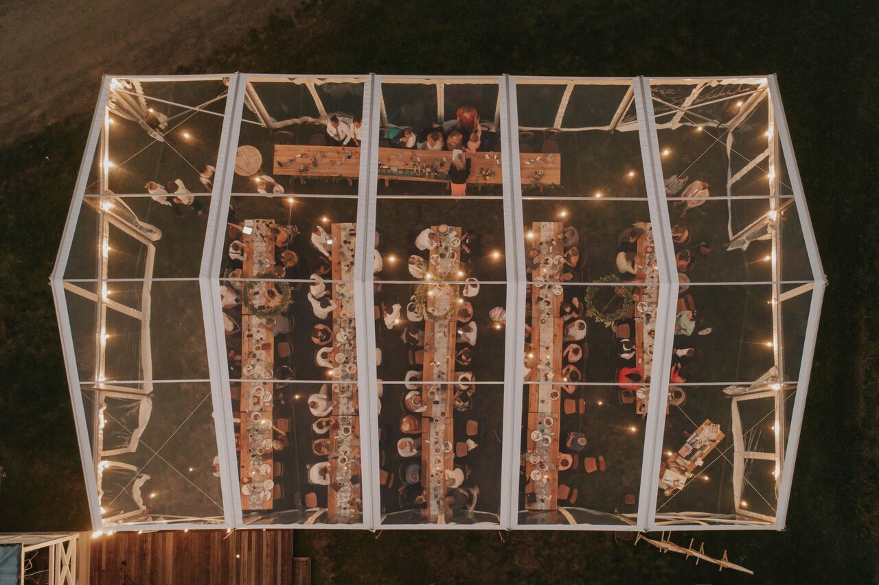 clear marquee from above looking down through clear roof to long table set up