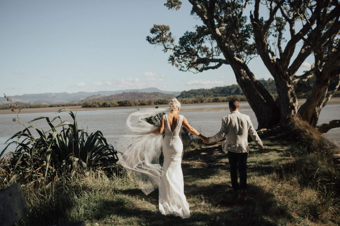 twelve-tables-creative-event-hire-nz-furniture-hire-whitianga-coromandel-bride and groom on cliff